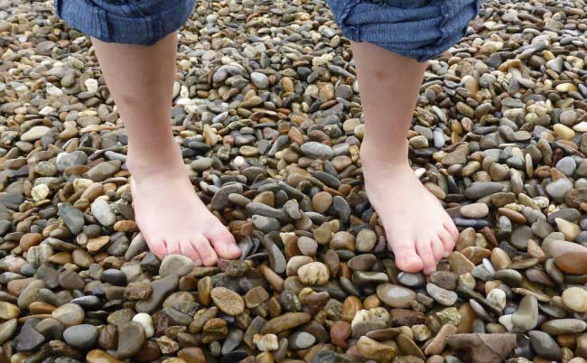 kids feet on beach